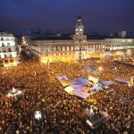 Demonstrators gather and shout slogans in Madrid's famous landmark Puerta del Sol